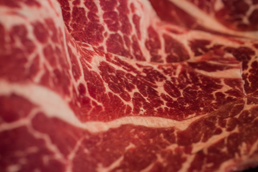 Marbling Japanese beef, raw beef, fresh meat. Wagyu beef macro. Beef wagyu with marbling texture.
