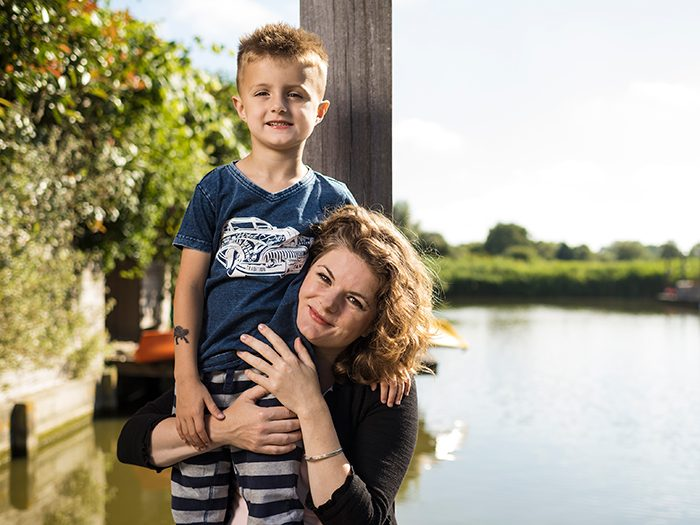 Micha now five years old, with his mother Nicole