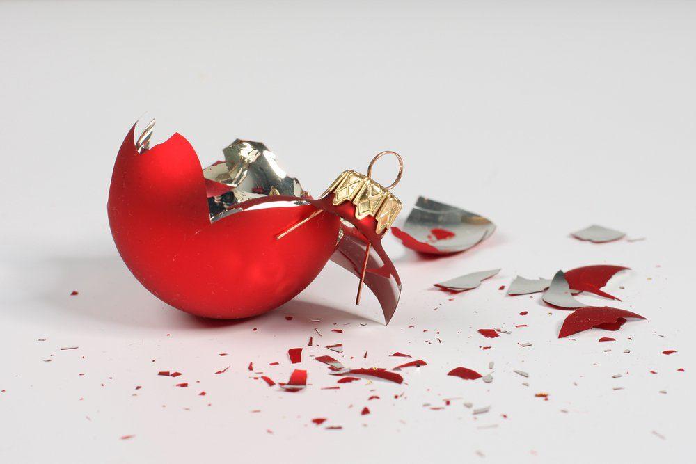 Broken christmas ball isolated on white