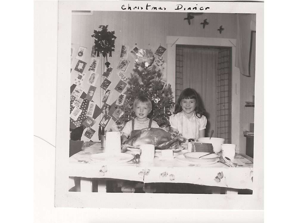 Two children getting ready to eat turkey on Christmas