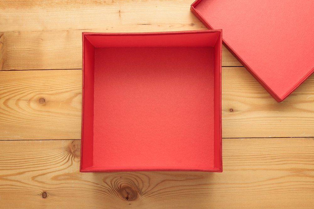 Empty gift box on a wooden background