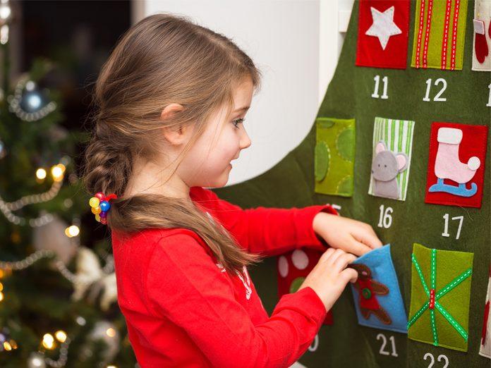 Kid with advent calendar
