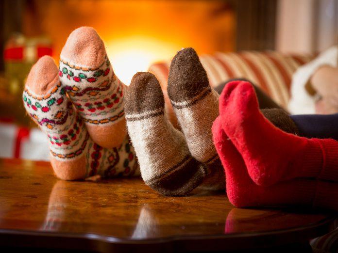 Family wearing fuzzy socks