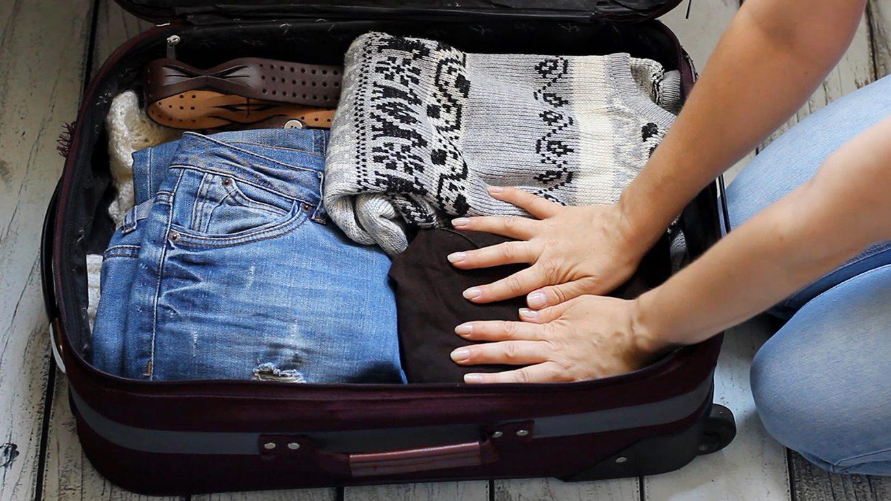 Great weekend getaways across Canada - woman packing weekend bag