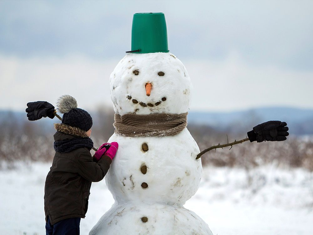 Kid making snowman