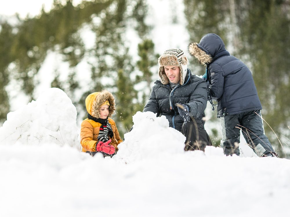 Family making snowman