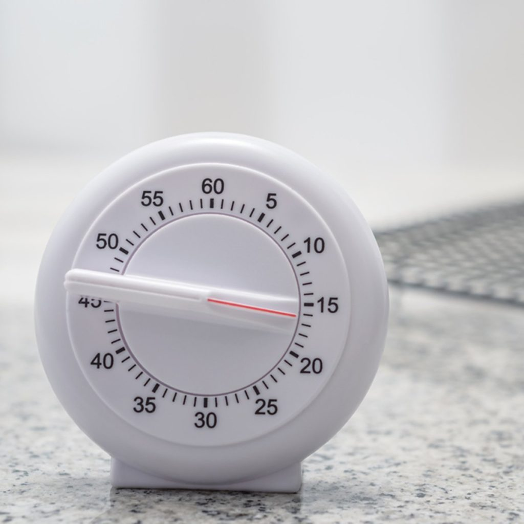 Timer on kitchen worktop with cooling rack in the background