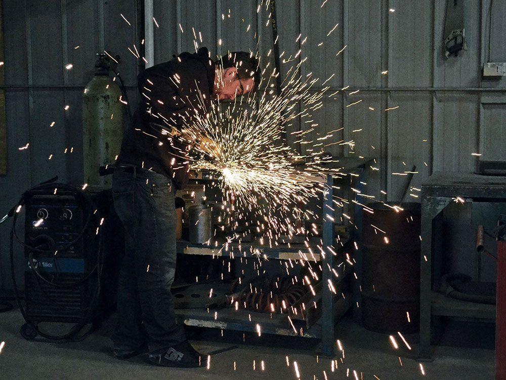 Man welding in his garage