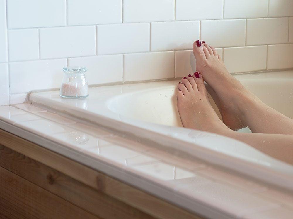 Soak hemorrhoids in warm water