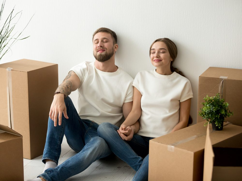 Young couple after moving into new home