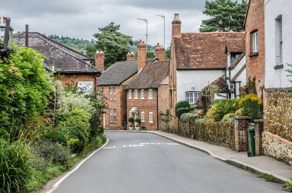 Road going into Shere Village Surrey UK