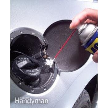 Lubricate gas tank lid
