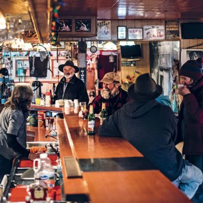 Leo Martel stands at the end of the bar in the Yukon's Keno City Hotel