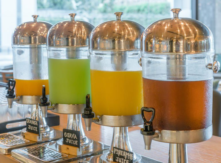 Row of fresh juice at buffet restaurant, Juice buffet self service in morning at hotel
