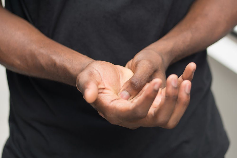 african man suffering from wrist or hand pain; sick black man with cps wrist pain, trigger finger, bone arthritis, gout symptoms; sickness, health care or pain concept; adult african man model