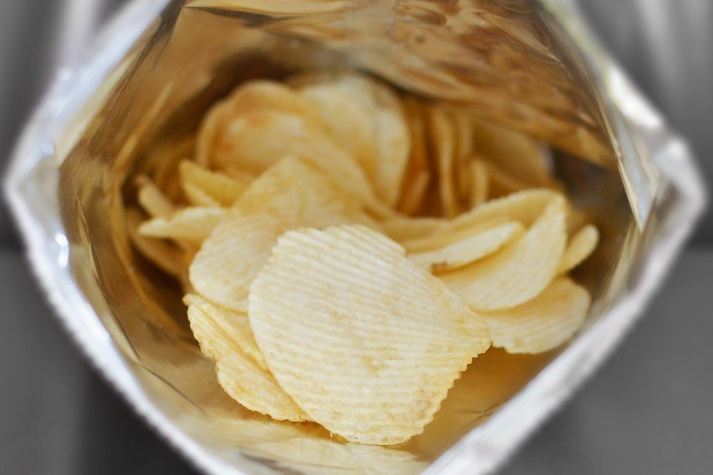 cose up of potato chips in bag