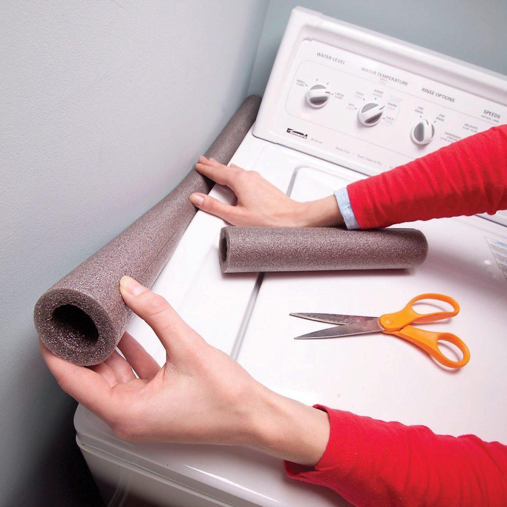foam pipe insulation next to washing machine laundry room