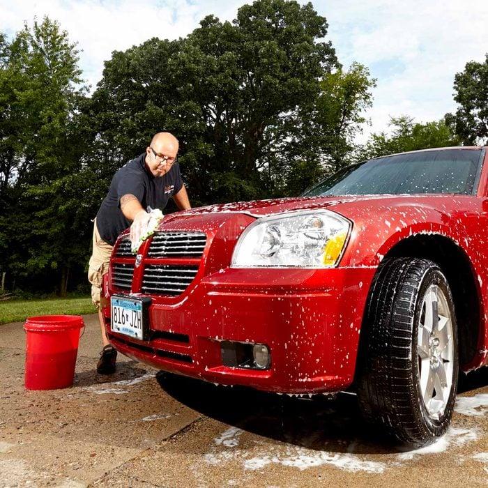 Man washing his van