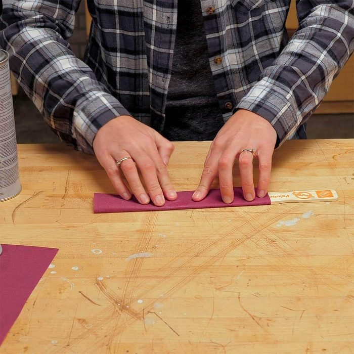 wrapping sandpaper around paint stick