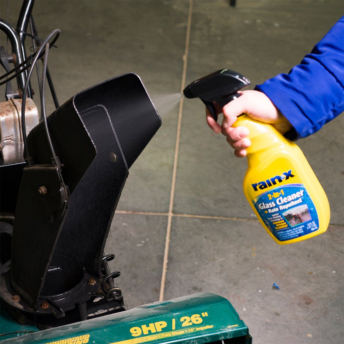 spraying rain-x inside snowthrower chute