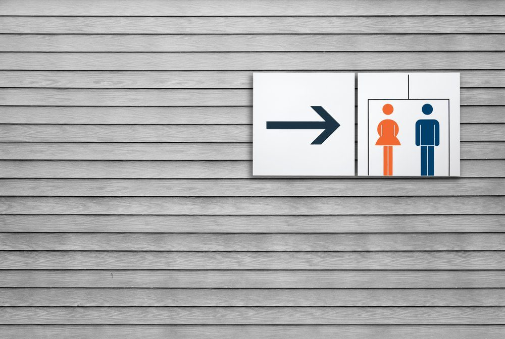 Unisex restroom or toilet and arrow sign