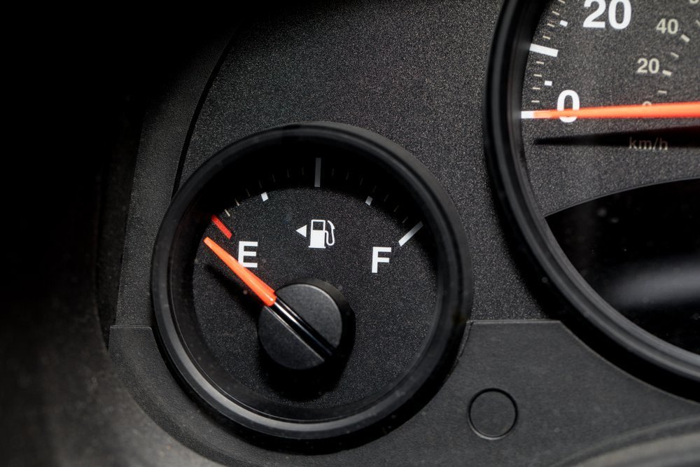 Low fuel guage shown in a car shot close up