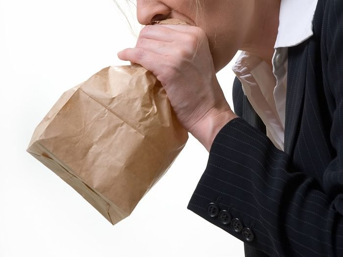 How to get rid of hiccups - breathe into a paper bag