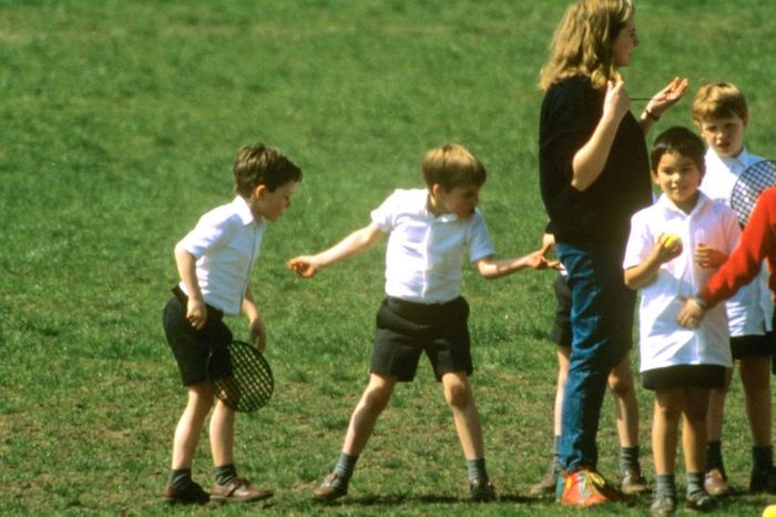 Prince William pinches his teacher's bottom whilst at his school games lesson in Richmond, London, Britain - Apr 1989