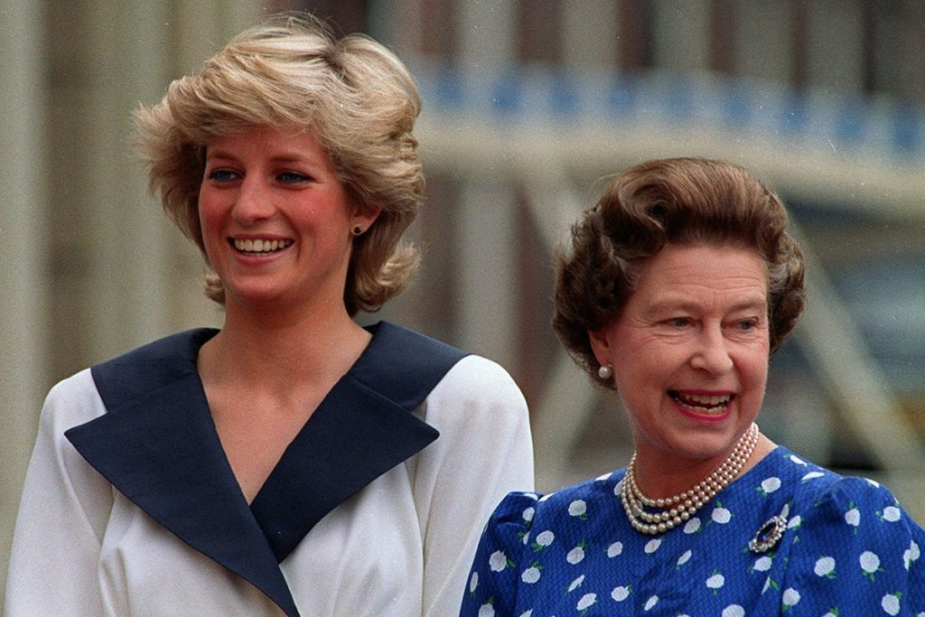 Diana, Princess of Wales, left, and Britain's Queen Elizabeth II smile to well-wishers outside Clarence House in London