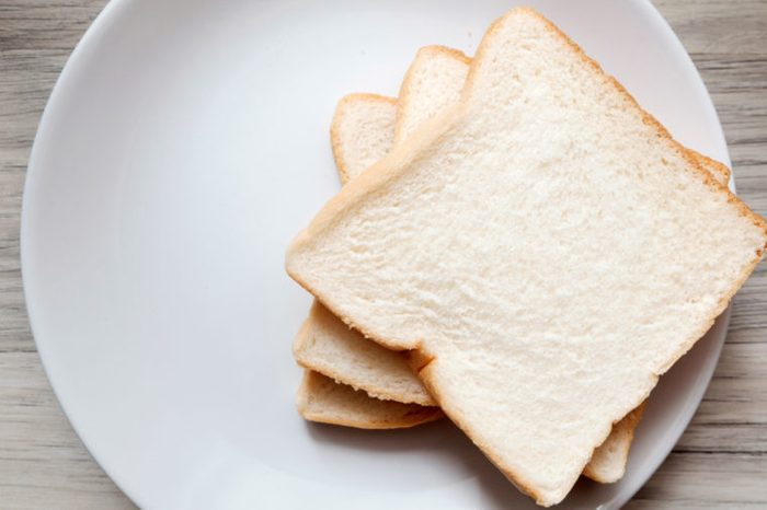 Toasted 3 slice of bread on white plate , Normal angel on the table , Selective focus