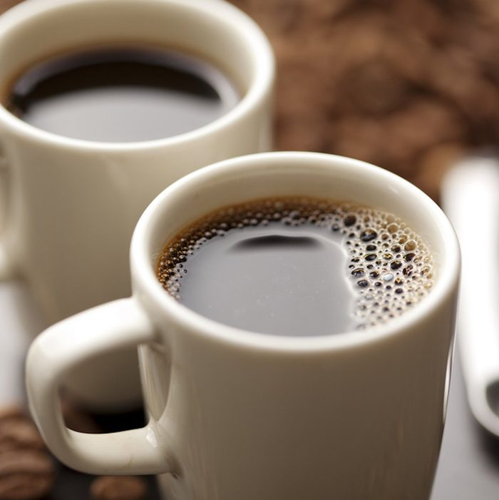 coffee cup filled with coffee beans;
