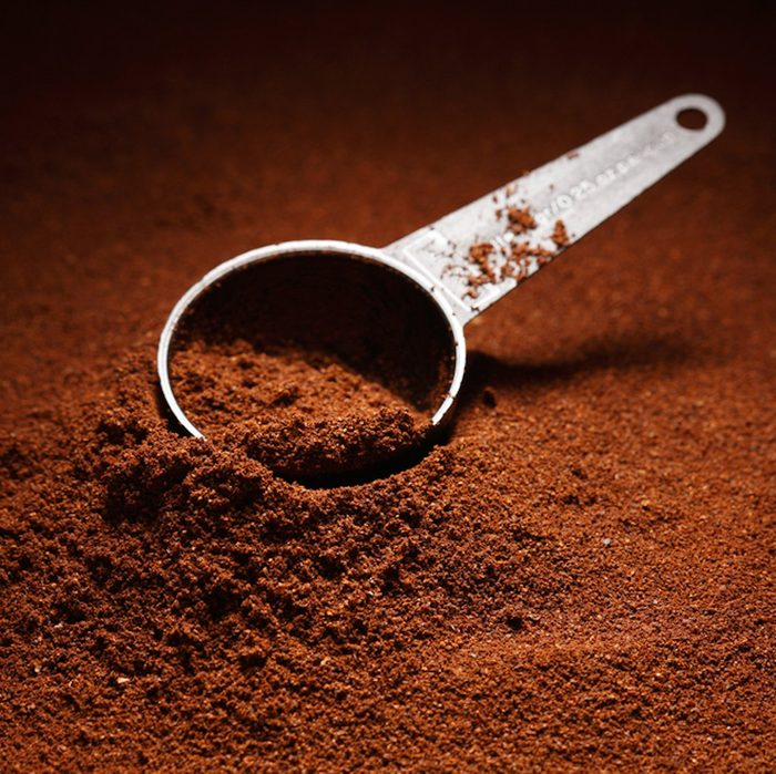 Ground coffee background / coffee scoop