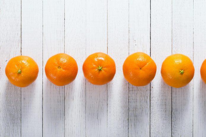 little tangerines on white wood table