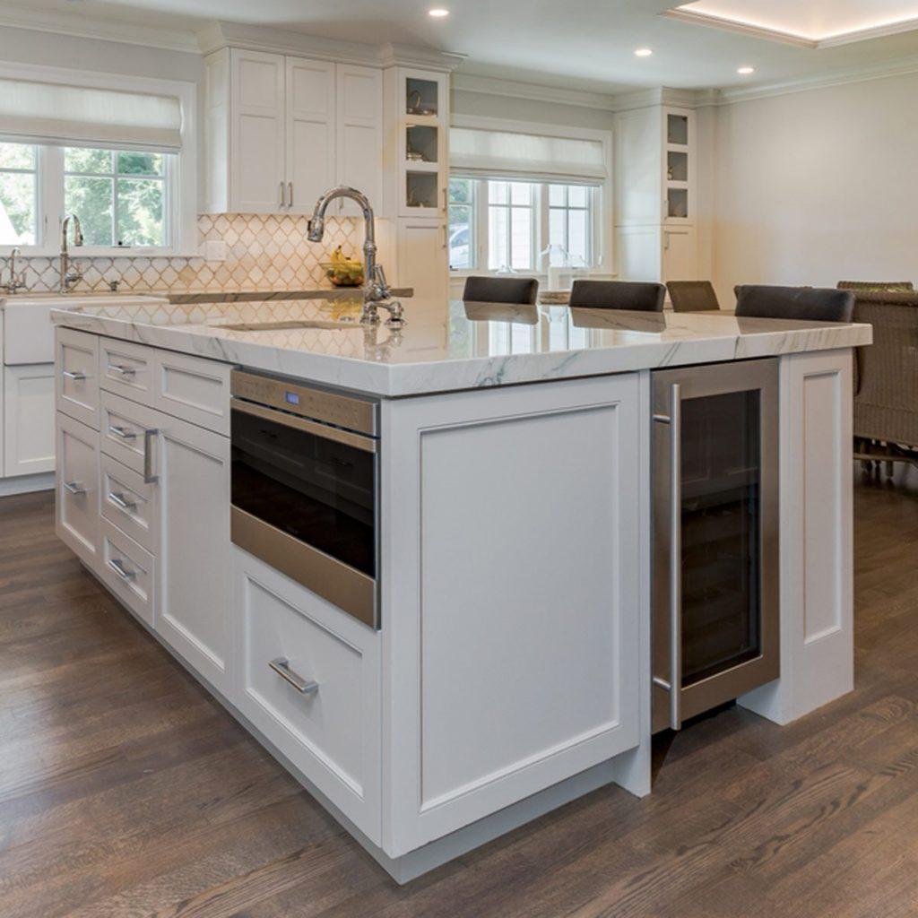 shutterstock_487408141 kitchen island with integrated appliances wine fridge