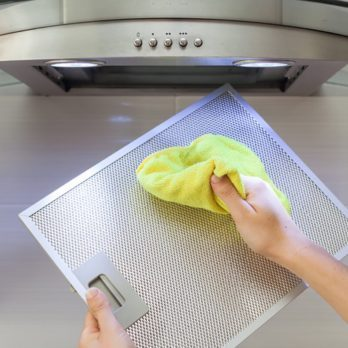 Here's Exactly How to Clean a Greasy, Dusty Oven Hood