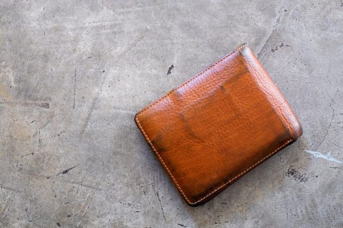 Old wallet texture on concrete floor background. empty purse with nobody.