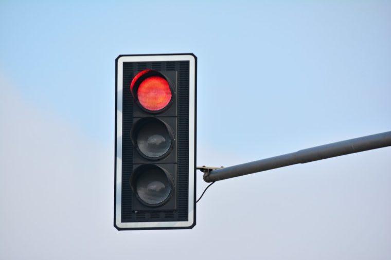 Traffic lights over blue sky