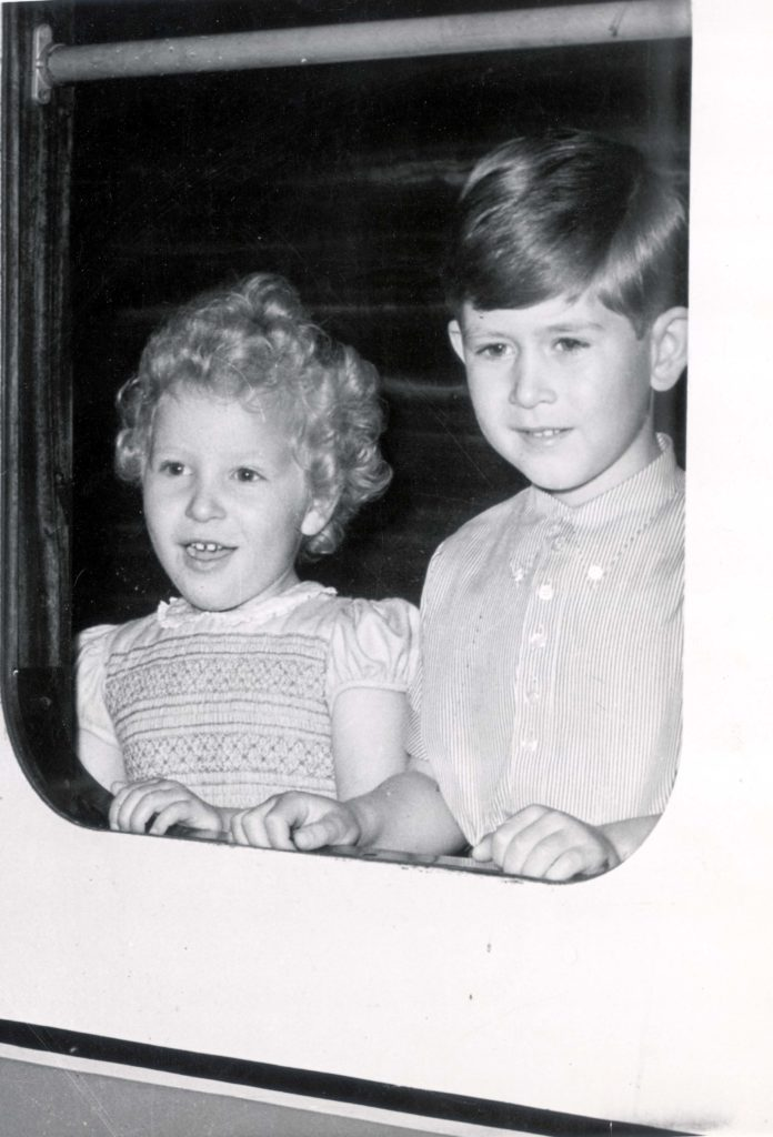 Prince Of Wales - 26th May 1954 Prince Charles And Princess Anne Pictured Framed In The Window Of The Royal Train When They Arrived At Balmoral For A Holiday....royalty