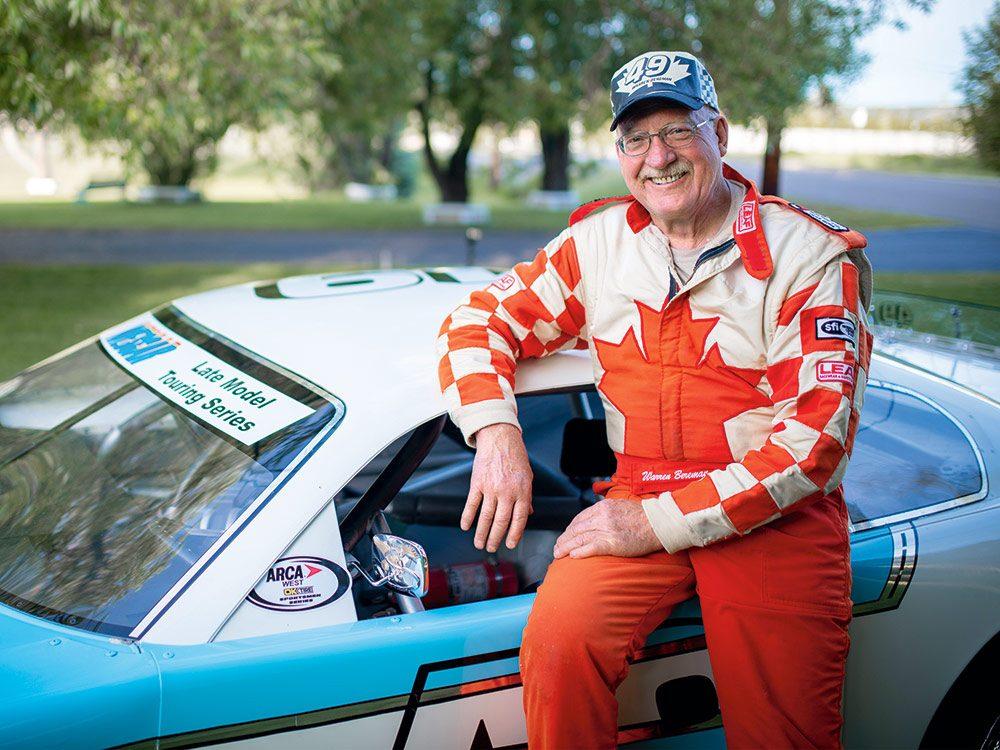 Warren posing next to his custom Chevy Camaro