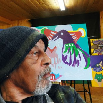 Indigenous artist Robert Burke at work in his studio