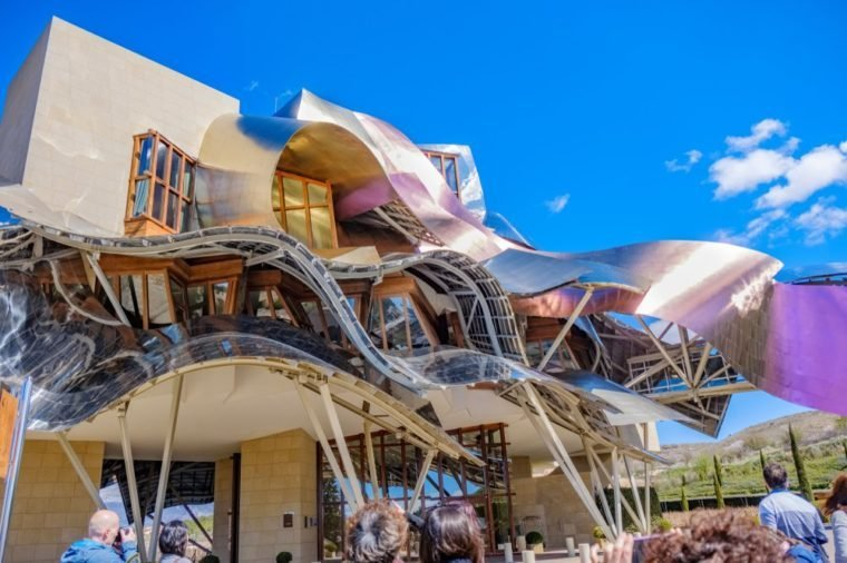 Elciego, Álava, Spain. April 23, 2018: Front view of a modern building with wavy aluminum structures designed by the architect Frank O. Gehry, for the Rioja wine cellars called Marqués de Riscal
