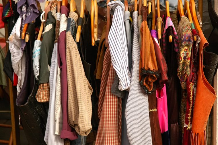 Rack of Vintage Old West Clothing, vests, dresses, shirts