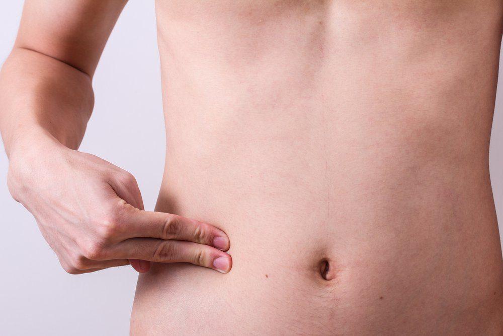 man finger push at belly or appendix