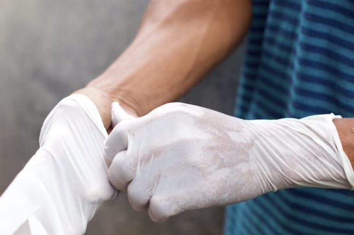 Wearing rubber gloves