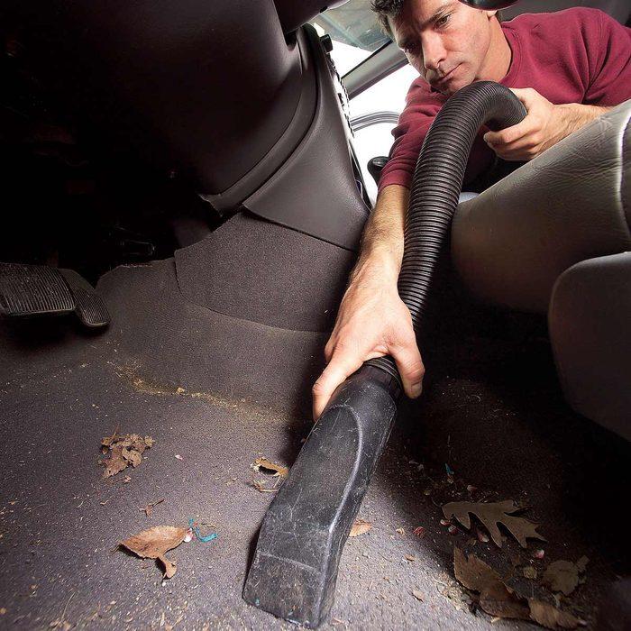 Vacuuming inside of car