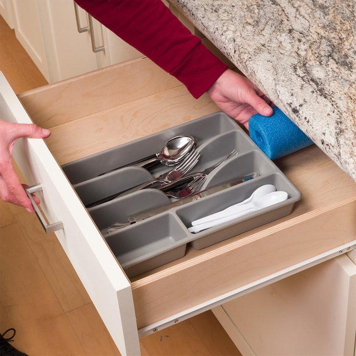 Home organizing hacks pool noodle inside drawer