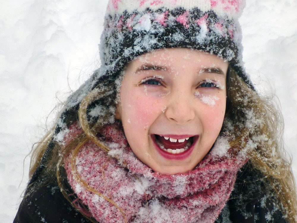 Little girl happy in winter