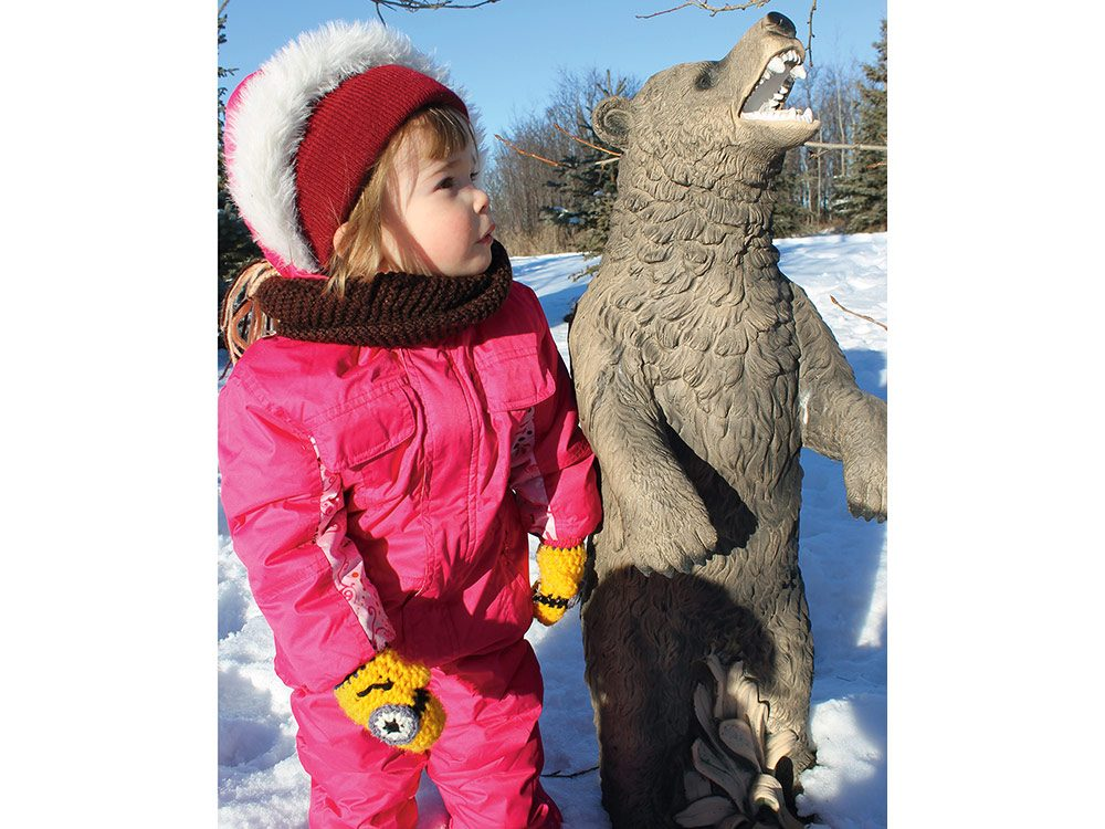 Little girl with bear statue