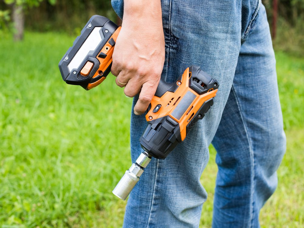 Man holding impact wrench
