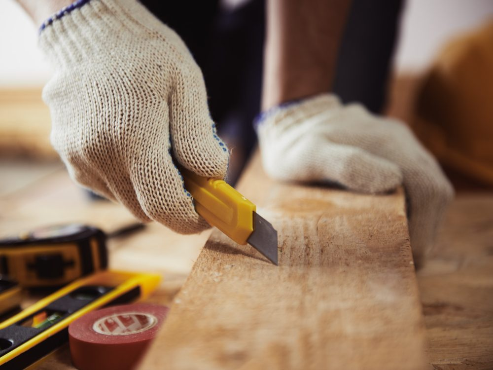 Contractor measuring wood